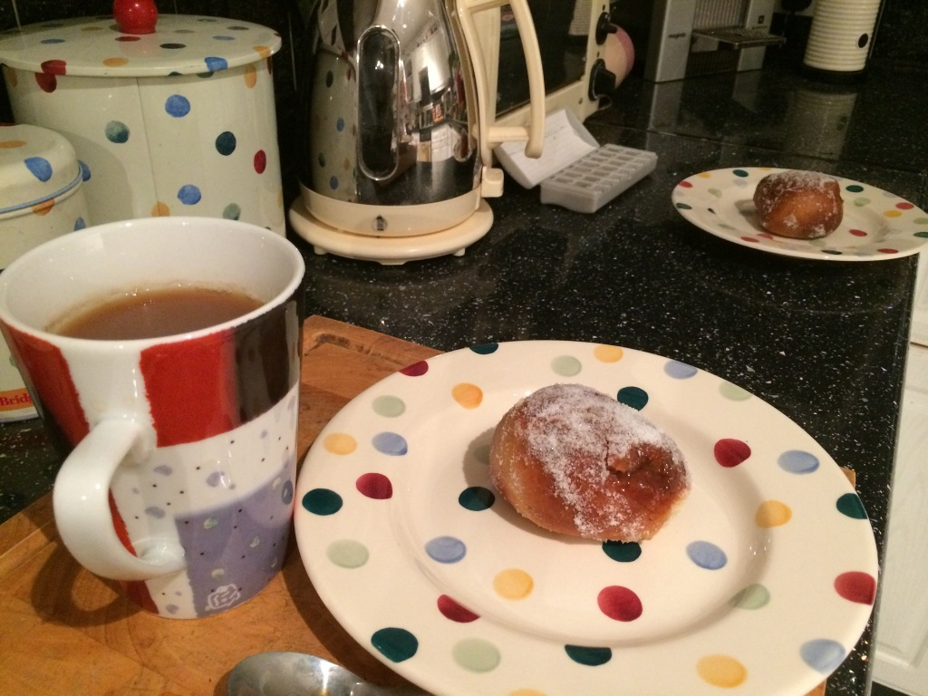 Jam doughnut and a cuppa
