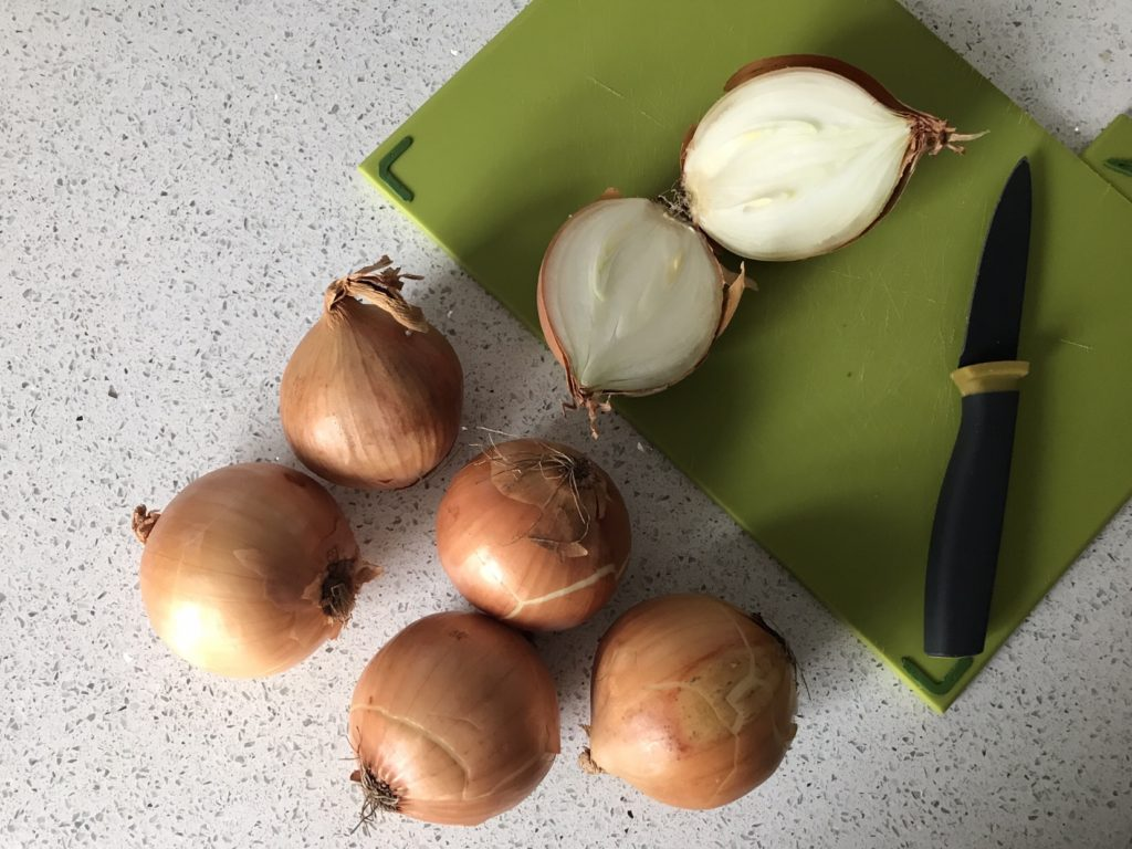 Onions on the chopping board