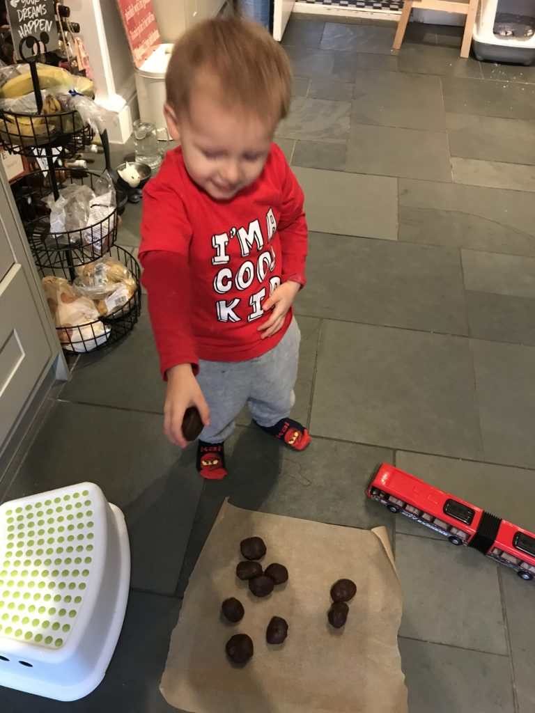 Ioan dropping cookies on a tray