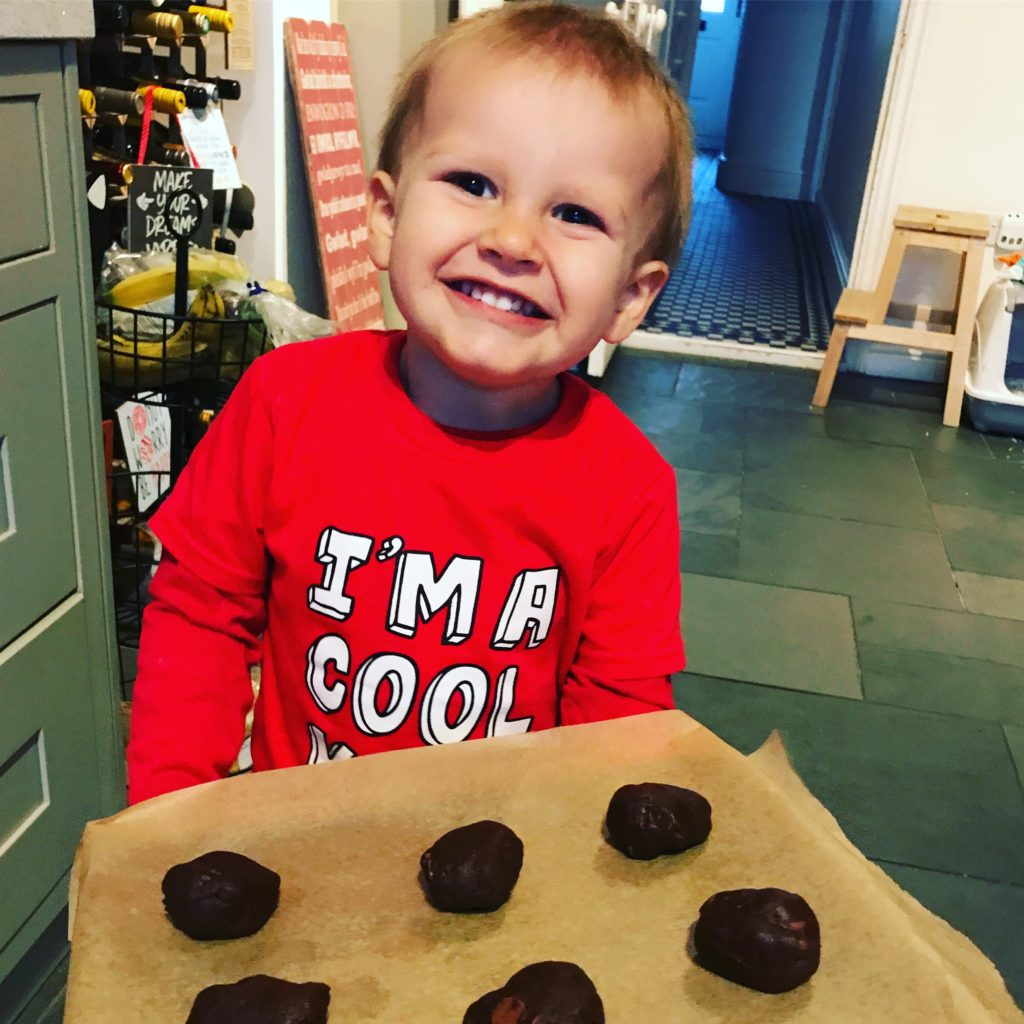 Ioan smiling with a tray of cookies