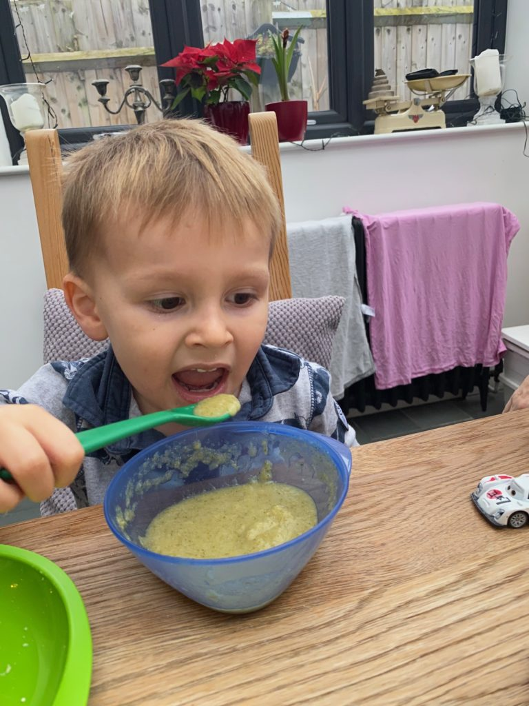 Ioan eating broccoli soup