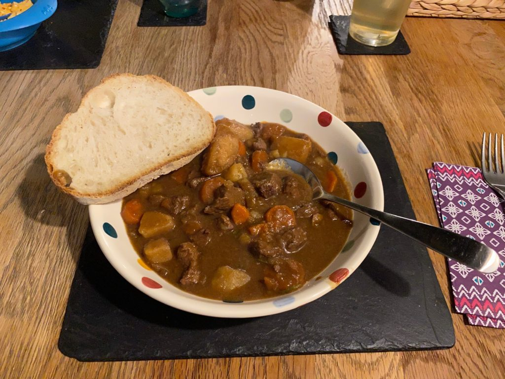 Beef with beer stew in a bowl with bread