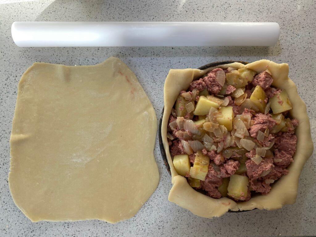 Welsh corned beef pie lid off