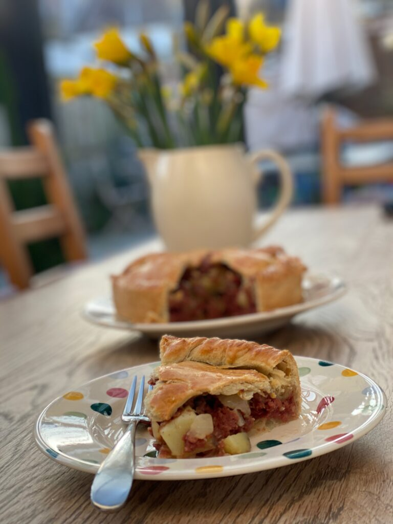 Welsh corned beef pie with daffodils