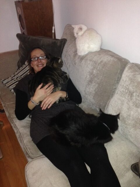 Tracy with all the cats